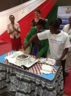 DVC Adminstration, Prof. Fatuma Chege cut a cake with a student during International Womens Day