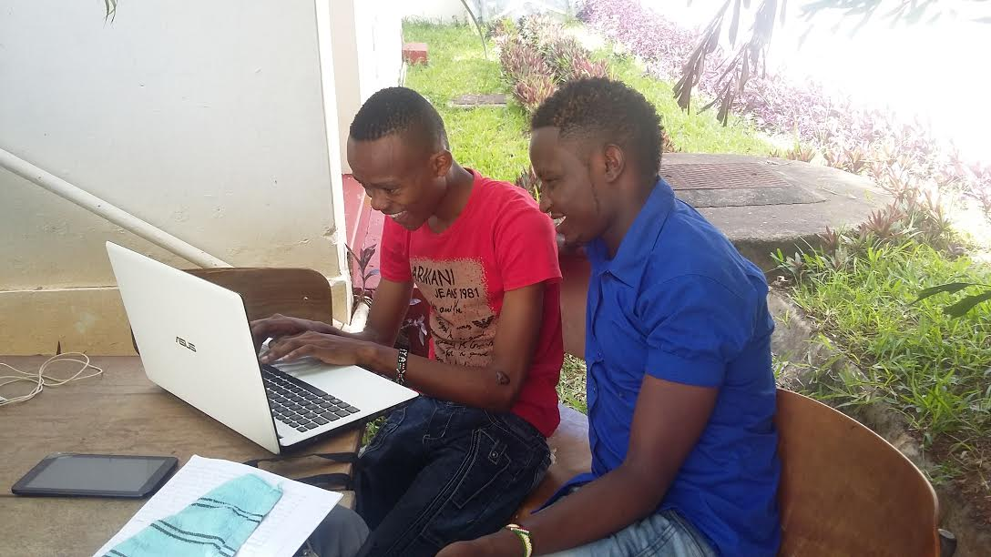 Mcharo Jeff  & Antony undertaking their assignment.They are pursuing Bachelor of Education at Mombasa Campus